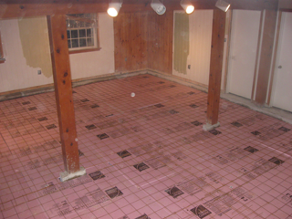 The old floor is gone, and the site ready for the heating pipes.