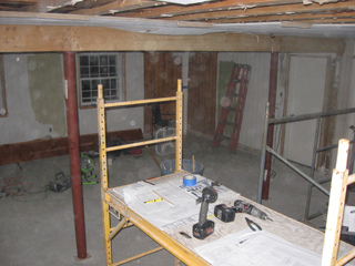 Most of the ceiling is gone, and work starts on the walls.
