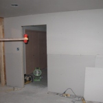 The drywall is hung on the mudroom wall