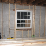The uninsulated wall is framed and ready for insulation