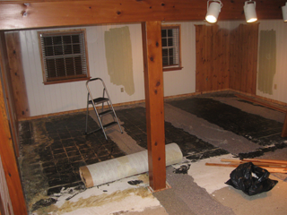 The room has some preliminary demolition: carpet and trim.