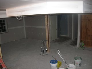 The drywall joints and holes are covered